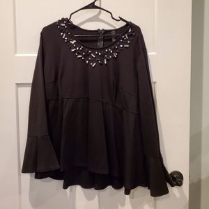 Peplum top with detail